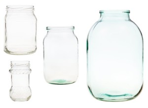 set of open glass jars isolated on white background